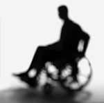sillouette of man in wheelchair