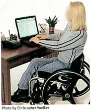 Figure 5: This keyboard is too far away from the user, causing her to reach forward awkwardly. Crossing the legs twists the torso and restricts circulation.