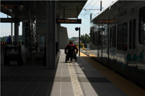 wheelchair user waiting at a Sound Transit station.