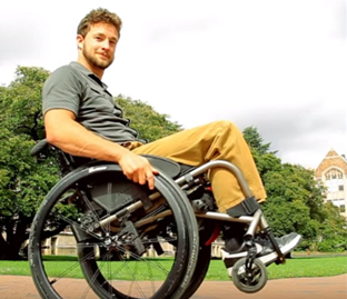 Wheelchair Skills Series Man In With Front Wheels Off The Ground Demonstrating A Wheelie